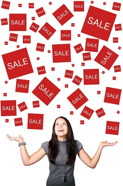 girl with sale signs