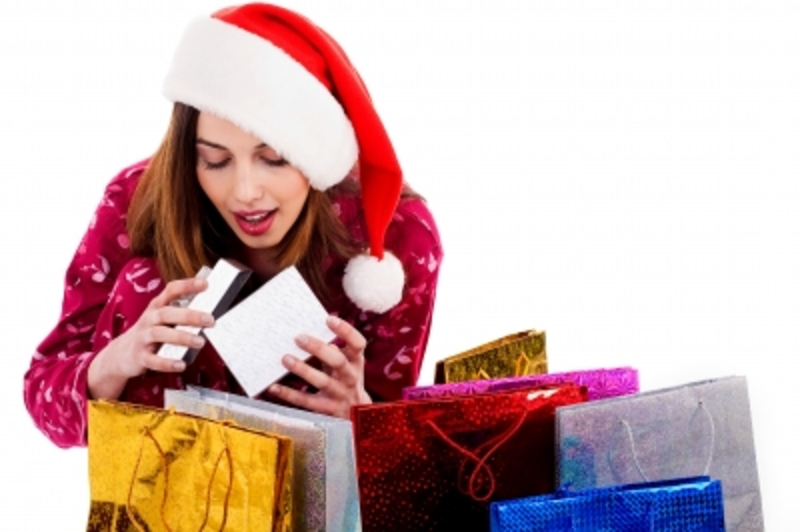 Woman With Christmas Shopping  - The Christmas Spending Trap